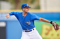 Dunedin Blue Jays shortstop Kevin Smith (4) throws to first base during a game against the Jupiter Hammerheads on August 14, 2018 at Dunedin Stadium in Dunedin, Florida.  Jupiter defeated Dunedin 5-4 in 10 innings.  (Mike Janes/Four Seam Images)