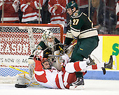 Rob Madore (Vermont - 29), Justin Courtnall (BU - 19), Anders Franzon (Vermont - 27) - The visiting University of Vermont Catamounts tied the Boston University Terriers 3-3 in the opening game of their weekend series at Agganis Arena in Boston, Massachusetts, on Friday, February 25, 2011.