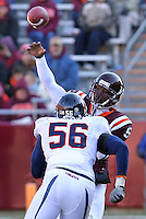 Nov 27, 2010; Charlottesville, VA, USA;  Virginia Tech Hokies quarterback Tyrod Taylor (5) throws the ball with pressure from Virginia Cavaliers defensive end Cam Johnson (56) during the game at Lane Stadium. Virginia Tech won 37-7. Mandatory Credit: Andrew Shurtleff