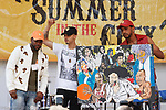 Designers Zae Diggs (left) Check Fernandez (center) and model stands on stage after their Trucking Fly fashion show, during Harlem Week 2017 at 135th Street and St. Nicholas Avenue in New York City on August 19, 2017.