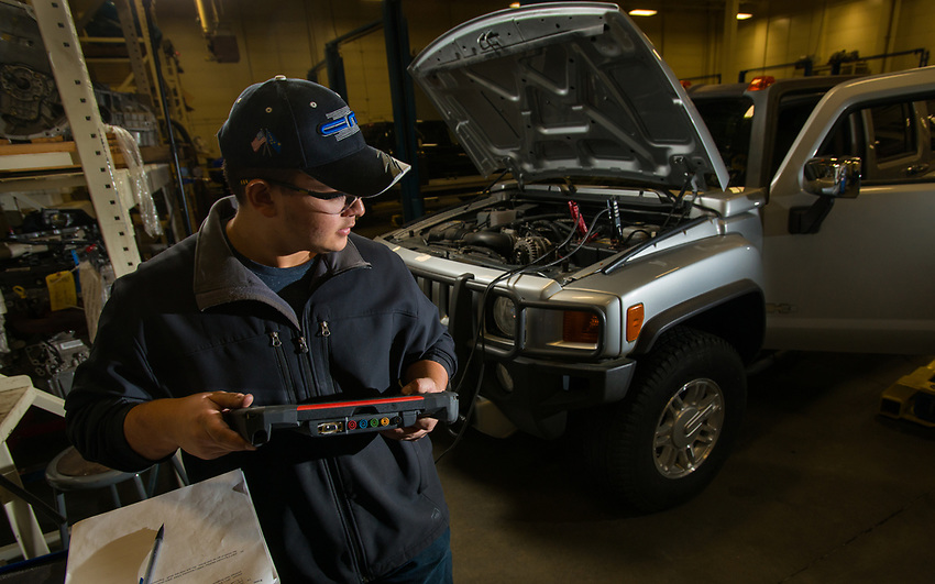 UAA Automotive Technology student Seth Hinson works on an assignment to diagnose a problem with an Engine Coolant Temperature (ECT) sensor on a Hummer H3 in UAA's Auto Diesel Technology Building.