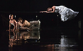 """L-R: Hannah Rudd, Stephen Wright and Kirsty Hopkins. Rambert Dance Company perform the new pice """"Labyrinth of Love"""" by choreographer Marguerite Donlon at Sadler's Wells Theatre, London. Music by Michael Daugherty, visual imagery by Mat Collishaw. With the soprano Kirsty Hopkins. Photo credit: Bettina Strenske"""