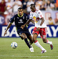 Tom Huddlestone, Macoumba Kandji. Tottenham defeated the New York Red Bulls, 2-1.