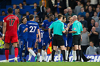 Chelsea players crowd round the officials at half time <br /> <br /> Photographer Craig Mercer/CameraSport<br /> <br /> The Premier League - Chelsea v Huddersfield Town - Wednesday 9th May 2018 - Stamford Bridge - London<br /> <br /> World Copyright &copy; 2018 CameraSport. All rights reserved. 43 Linden Ave. Countesthorpe. Leicester. England. LE8 5PG - Tel: +44 (0) 116 277 4147 - admin@camerasport.com - www.camerasport.com