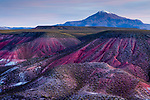 Clay rock formations and volcano, Valley of the Moon, Abra Granada, Andes, northwestern Argentina