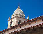 Monterey County, CA<br /> Tower of the Carmel Mission Basilica (1797) rise above the tiled roofs of the cloister walk - Mission San Carlos Borromeo del Rio Carmelo
