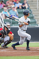 Gosuke Katoh (4) of the Charleston RiverDogs follows through on his swing against the Kannapolis Intimidators at CMC-NorthEast Stadium on June 28, 2014 in Kannapolis, North Carolina.  The Intimidators defeated the RiverDogs 4-3. (Brian Westerholt/Four Seam Images)