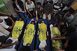 Palestinians mourn over the body of boys from the Baker family, whom medics said was killed with three other children from the same family by a shell fired by an Israeli naval gunboat, in Gaza city on Julu 16, 2014. Four Palestinian children were killed and one was critically wounded on a Gaza beach by the shell fired by the Israeli naval gunboat, a Palestinian health official said. Asked about the incident, an Israeli military spokesman in Tel Aviv said he was checking the report. Gaza health officials said 213 Palestinians, most of them civilians, had been killed in air and naval barrages, in the worst flareup of Israeli-Palestinian violence in two years. One Israeli has been killed by shelling from Gaza that has made a race to shelter a daily routine for hundreds of thousands in Israel. Photo by Ashraf Amra