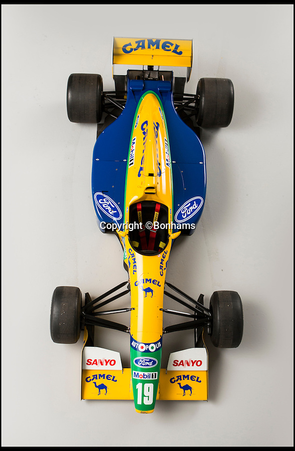 BNPS.co.uk (01202 558833)<br /> Pic: Bonhams/BNPS<br /> <br /> The Formula 1 car superstar Michael Schumacher tore across Mexico City to his first podium finish in 1992 has raced into auction. <br /> <br /> The yellow and blue Benetton-Ford single-seater boy's toy is running with its original parts and can still reach terrifying speeds of 200mph.<br /> <br /> Whoever buys the amazing relic from Schumacher's glittering career wont be able to use it to beat their morning commute, as sadly it isn't road legal. <br /> <br /> The car has been valued at £222,000, but there is no reserve - meaning whatever the price when the hammer drops it will be sold.