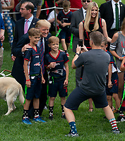 United States president Donald J. Trump poses for photos with kids participating in the White House Sports and Fitness Day at the White House in Washington, DC, May 30, 2018. <br /> CAP/MPI/RS<br /> &copy;RS/MPI/Capital Pictures