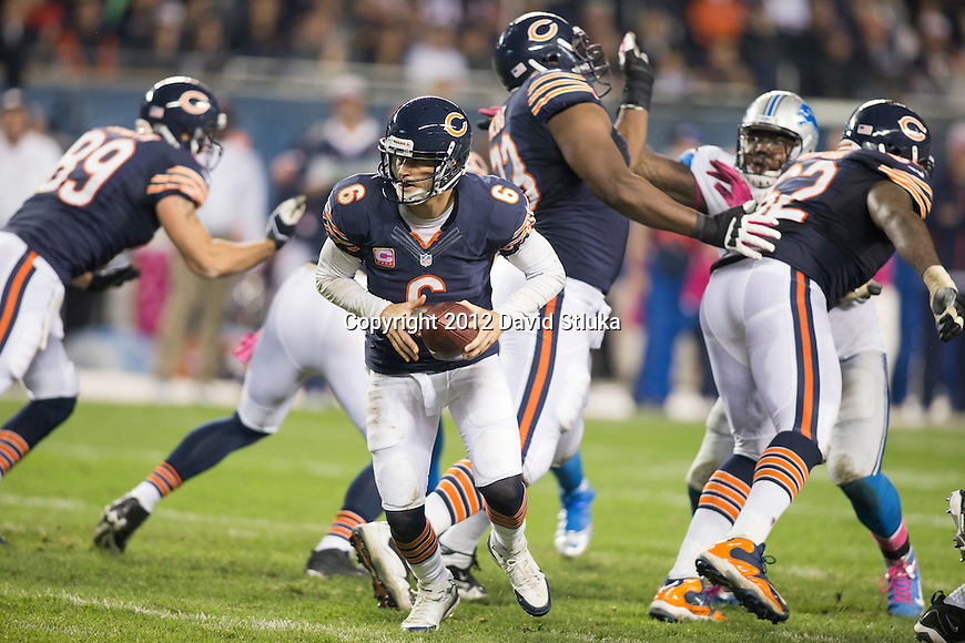Chicago Bears quarterback Jay Cutler (6) handles the ball during a Week 7 Monday Night NFL football game against the Detroit Lions Monday, October 22, 2012 in Chicago. The Bears won 13-7. (AP Photo/David Stluka)