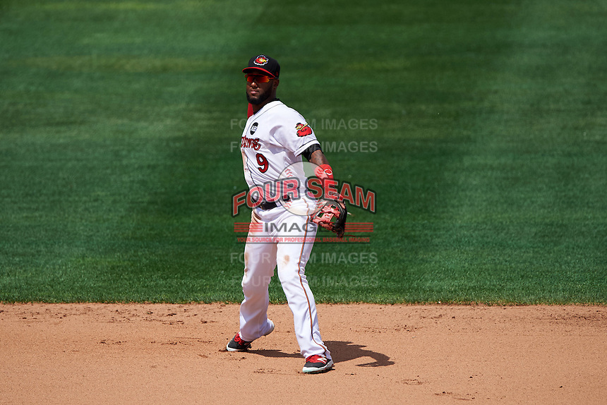 Rochester Red Wings second baseman Danny Santana (9) throws to first during a game against the Columbus Clippers on June 16, 2016 at Frontier Field in Rochester, New York.  Rochester defeated Columbus 6-2.  (Mike Janes/Four Seam Images)
