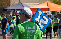 Seahawk Fan holding 12th man Flag, Seahawks 12K Run 2016, The Landing, Renton, Washington, USA.