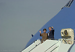 President George W. Bush and First Lady Laura Bush wave good-bye before boarding Air Force One in Tampa.