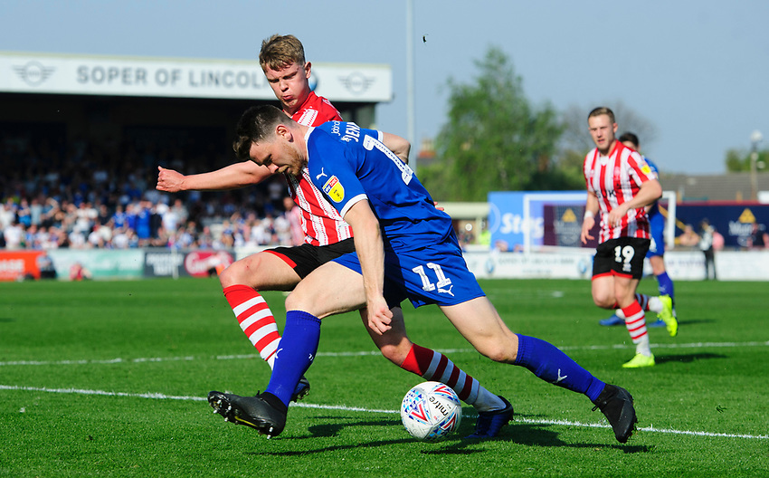 Tranmere Rovers' Connor Jennings under pressure from Lincoln City's Mark O'Hara<br /> <br /> Photographer Chris Vaughan/CameraSport<br /> <br /> The EFL Sky Bet League Two - Lincoln City v Tranmere Rovers - Monday 22nd April 2019 - Sincil Bank - Lincoln<br /> <br /> World Copyright © 2019 CameraSport. All rights reserved. 43 Linden Ave. Countesthorpe. Leicester. England. LE8 5PG - Tel: +44 (0) 116 277 4147 - admin@camerasport.com - www.camerasport.com