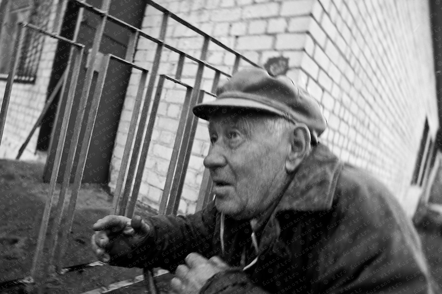 Documenting the echos of Chernobyl Tragedy,An old man in the exclusion zone, near Prypiat. This area serves as a long term reminder of the mass destruction caused by the nuclear explosion in Chernobyl, Ukraine on April 25-26, 1986.
