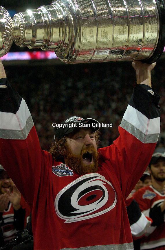 Mike Commodore holds the Stanley Cup after the Carolina Hurricanes beat the Edmonton Oilers 3-1 in game seven to win the series at the RBC Center in Raleigh, NC Monday, June 19, 2006.