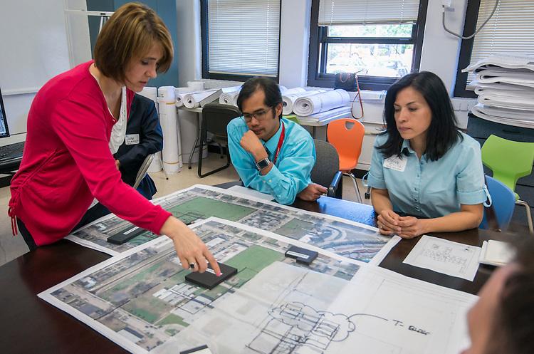 Project advisor team members for Pilgrim Academy confer about design options during a design charrette, April 29, 2015.