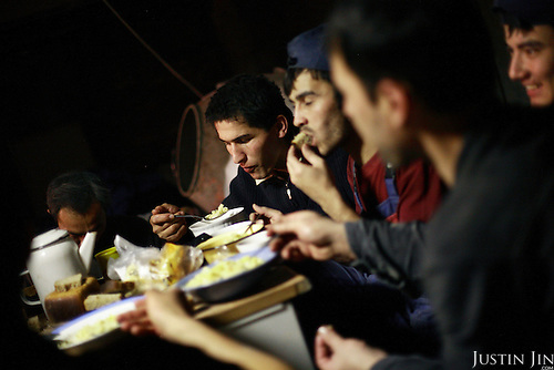 Migrant workers from Uzbekistan eat in a construction site in Moscow where they work and temporarily live. The workers are crammed 8 to this basement..Lowe down in the social pecking order in Russia are the Tajiks,.Uzbeks and poor whites from odd places such as.Transdniestr, the Slav enclave of Moldova, who work on.construction sites in the booming city centre and.sleep 12 to a room in dingy hostels on the outskirts..Fights break out regularly in these places, over job.openings, over ethnic differences.