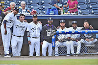 Asheville Tourists players (L-R) Carlos Polanco (18), Roberto Ramos (27), Luis Jean (3), Jairo Rosario (30), Omar Carrizales (19), Cesar Galvez (1) and Jonathan Daza (2) before game one of the Southern Division South Atlantic League Playoffs against the Savannah Sand Gnats on September 9, 2015 in Asheville, North Carolina. The Tourists defeated the Sand Gnats 5-1. (Tony Farlow/Four Seam Images)