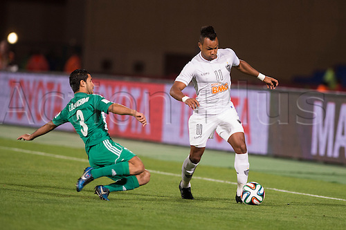 18.12.2013. Marrakesh, Morocco.  (L-R) Zakaria El Hachimi (Raja), Fernandinho (Atletico Mineiro),  FIFA Club World Cup Morocco 2013 Semi-final match between Raja Casablanca 3-1 Atletico Mineiro at Stade de Marrakech in Marrakesh, Morocco.