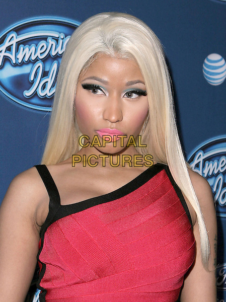 Nicki Minaj .American Idol premiere event held at Royce Hall at UCLA in Westwood, California, USA..9th January 2013                                                                   .headshot portrait red black trim pink lipstick dyed blonde hair blue eyeshadow make-up .CAP/DVS.©DVS/Capital Pictures.