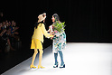 Japanese designer Yuma Koshino receives a bouquet of flowers after her 2017 spring/summer collection in Tokyo as a part of Tokyo Fashion Week on Friday, October 21, 2016. (Photo by Michael Steinebach/AFLO)