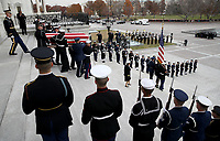 A U.S. military honor guard team carries the flag draped casket of former U.S. President George H. W. Bush from the U.S. Capitol December 5, 2018 in Washington, DC. A funeral service will be held today for former U.S. President Bush at the Washington National Cathedral. President Bush will be buried at his final resting place at the George H.W. Bush Presidential Library at Texas A&amp;M University in College Station, Texas. A WWII combat veteran, Bush served as a member of Congress from Texas, ambassador to the United Nations, director of the CIA, vice president and 41st president of the United States.<br /> CAP/MPI/RS<br /> &copy;RS/MPI/Capital Pictures
