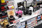 Colorful Pentax cameras on display in electronics store Yodobashi Camera, Yodobashi-Akiba in Akihabara, Tokyo, Japan.