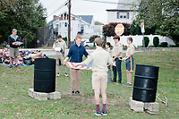 Boy Scouts and Cub Scouts gather to start a flag retirement ceremony in Belmont, Massachusetts, USA, on Sat. Oct. 14, 2017. Flags were burned as part of the ceremony in order to give a dignified end to flags no longer fit to serve as a symbol for the United States of America. The ceremony was organized by Eagle Scout candidate Robert Mountain, 17, of Belmont Boy Scout Troop 66 as his Eagle Scout project.  The ceremony was held in park area surrounding Clay Pit Pond near Belmont High School.
