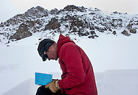 Colorado Avalanche Information Center (CAIC) Avalanche Forecaster Tim Brown (cq) takes notes on his observations doing test in snow pack at Coon Hill, which stands about 11,150 feet in elevation, near Summit County in Colorado, Thursday, February 16, 2012. Tests at this area showed that there was a fairly hard slab of snow resting on weaker snow beneath making conditions which can lead to avalanches...Photo by Matt Nager