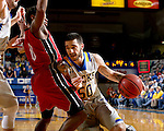 BROOKINGS, SD - DECEMBER 31:  Michael Orris #50 from South Dakota State University takes the ball to the basket against Trey Dickerson #0 from the University of South Dakota during their game Saturday afternoon at Frost Arena in Brookings. (Dave Eggen/Inertia)