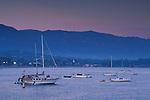 Boats anchored offshore below distant coastal mountains, Santa Barbara, Southern Coast, California