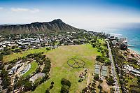 An aerial view of a human peace sign created on a sunny day in Kapi'olani Park, Honolulu, O'ahu.