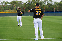Pittsburgh Pirates Garth Brooks (7) warms up with Kevin Newman (27) during the teams first Spring Training practice on February 18, 2019 at Pirate City in Bradenton, Florida.  (Mike Janes/Four Seam Images)