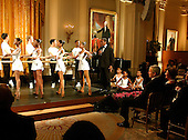 Washington, D.C. - February 6, 2006 -- United States President George W. Bush and first lady Laura Bush (at far right center)watch Arthur Mitchell, Founder and Artistic Director, Dance Theatre of Harlem shows off his dancers during a performance in the East Room of the White House in Washington, D.C. on February 6, 2006. <br /> Credit: Ron Sachs / CNP