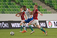 Kostas Fortounis (L) of Greece and Laszlo Kleinheisler (R) of Hungary fight for the ball during the UEFA Nations' League qualifying match between Hungary and Greece at the Groupama Arena stadium in Budapest, Hungary on Sept. 11, 2018. ATTILA VOLGYI