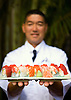 "Sushi chef Tadashi Yoshino with a ""rainbow roll"" at Kai, the sushi bar at the Ritz-Carlton Kapalua on Maui, Hawaii. Photo by Kevin J. Miyazaki/Redux"