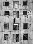 Windows, abandoned grain elevator along the railroad track, San Joaquin, California