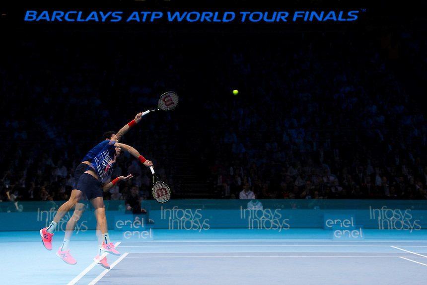 (Editors note - multiple exposures in-camera used) Milos Raonic of Canada in action against Dominic Thiem of Austria in their Group Ivan Lendl match today<br /> <br /> Photographer Craig Mercer/CameraSport<br /> <br /> International Tennis - Barclays ATP World Tour Finals - Day 5 - Thursday 17th November 2016 - O2 Arena - London<br /> <br /> World Copyright &copy; 2016 CameraSport. All rights reserved. 43 Linden Ave. Countesthorpe. Leicester. England. LE8 5PG - Tel: +44 (0) 116 277 4147 - admin@camerasport.com - www.camerasport.com