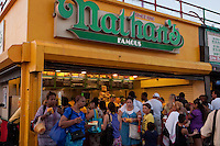 People masses around Nathan's Famous stand on Coney Island boardwalk in New York city borough of Brooklyn, Sunday July 31, 2011. Nathan's Famous (NASDAQ: NATH) is a company that operates a chain of U.S.-based fast food restaurants specializing in hot dogs.