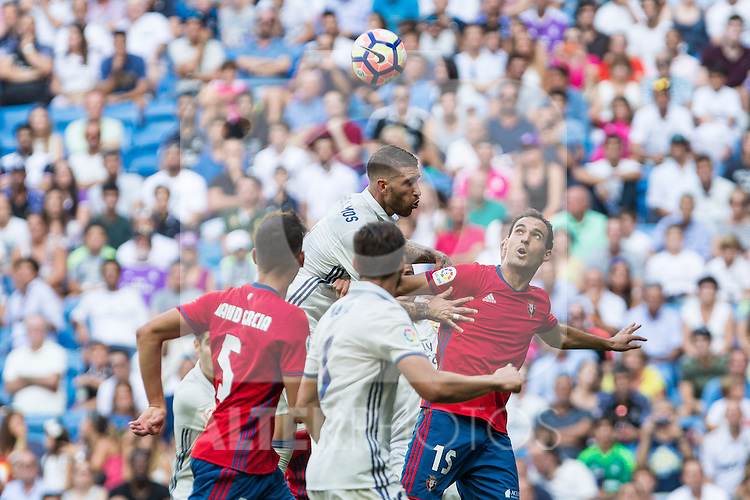 Real Madrid's Sergio Ramos and Club Atletico Osasuna's Unai Garcia during the match of La Liga between Real Madrid and Club Atletico Osasuna at Santiago Bernabeu Estadium in Madrid. September 10, 2016. (ALTERPHOTOS/Rodrigo Jimenez)
