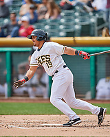 Carlos Perez (19) of the Salt Lake Bees follows through on his swing gainst the El Paso Chihuahuas in Pacific Coast League action at Smith's Ballpark on April 30, 2017 in Salt Lake City, Utah. El Paso defeated Salt Lake 3-0. This was Game 1 of a double-header. (Stephen Smith/Four Seam Images)