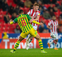 4th November 2019; Bet365 Stadium, Stoke, Staffordshire, England; English Championship Football, Stoke City versus West Bromwich Albion; Sam Clucas of Stoke City is tackled by Jake Livermore of West Bromwich Albion - Strictly Editorial Use Only. No use with unauthorized audio, video, data, fixture lists, club/league logos or 'live' services. Online in-match use limited to 120 images, no video emulation. No use in betting, games or single club/league/player publications