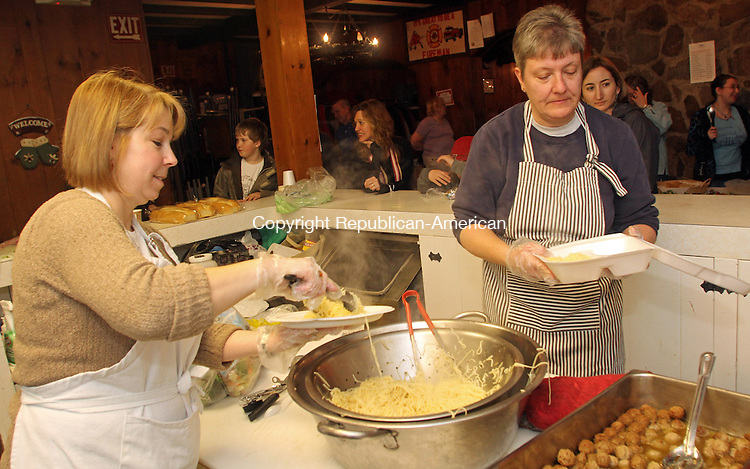 New Hartford, CT-030113MK02 (from left) Selectman Alesia Kennerson  and Irene Brown prepare pasta dinners during a fundraiser to benefit the Neighbor to Neighbor Community fund at the Pine Meadow Firehouse in New Hartford on Friday night.  Richard ST. John, board member, said that the proceeds raised will go to help New Hartford residents in need of assistance with electric, fuel and medical bills.  Penny Miller, another board member, said that in the past two years the fund, organized by local clergy and local non-profit organizations members, has been able to raise twenty thousand dollars which helped twenty six local families.  Miller also indicated that fifty tickets were pre-sold for this event with an additional one-hundred twenty tickets had been sold at the door. Michael Kabelka / Republican-American