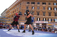 "Roma, .quartiere San Lorenzo.Manifestazione sportiva itinerante""lo sport sotto casa"" organizzata da varie associazioni sportive popolari.. una esibizione di soft boxe..Rome.San Lorenzo.Sporting event traveling ""Sport under house,"" organized by various sports associations Popular. a display of soft boxing."