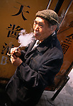 Senior man smoking pipe; truck; loading dock; Xiu Tian street market; tobacco use; Chongqing, China, Asia; 041603