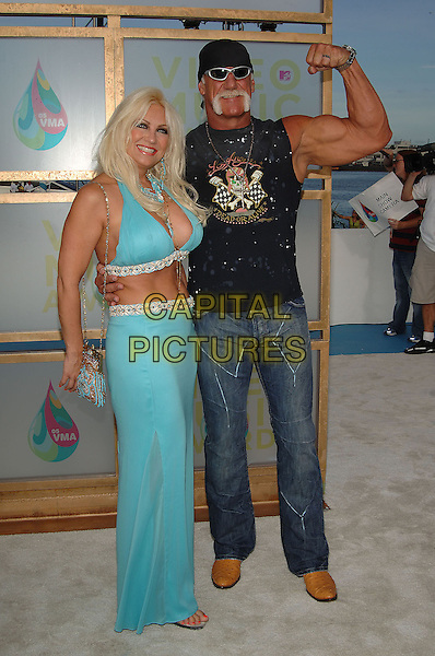 HULK HOGAN & WIFE LINDA.MTV Video Music Awards.Arrivals held at the American Airlines Arena,.Miami, 28th August 2005.full length turquoise halter neck top belly cleavage skirt sleeveless t-shirt denim jeans bandana sunglassses muscle arm.Ref: ADM/JW.www.capitalpictures.com.sales@capitalpictures.com.© Capital Pictures.