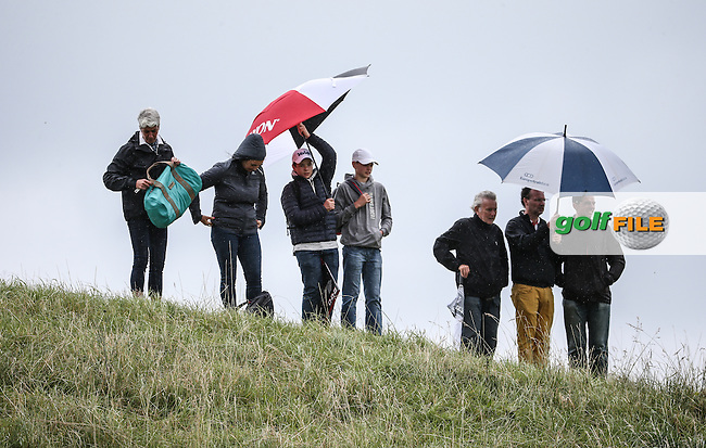 The umbrellas are up during Round One of the 100th Open de France, played at Le Golf National, Guyancourt, Paris, France. 30/06/2016. Picture: David Lloyd | Golffile.<br /> <br /> All photos usage must carry mandatory copyright credit (&copy; Golffile | David Lloyd)