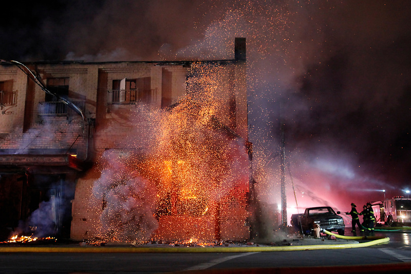 The burning roof of the first floor collapses as firefighters work to contain a massive blaze that consumed The Swinging Door building on Soledad Street in Salinas' Chinatown on March 18, 2017.